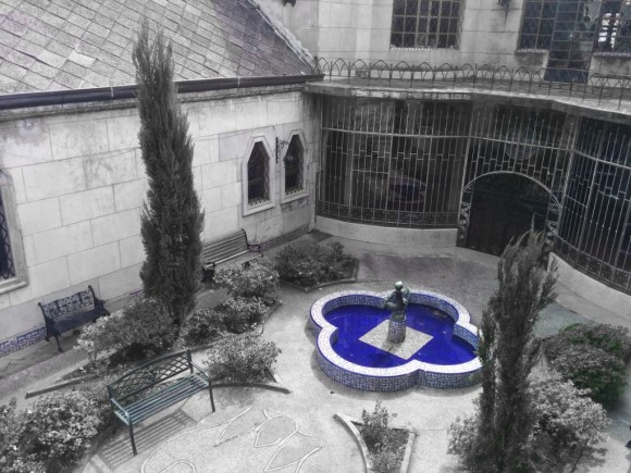 courtyard with a blue pond