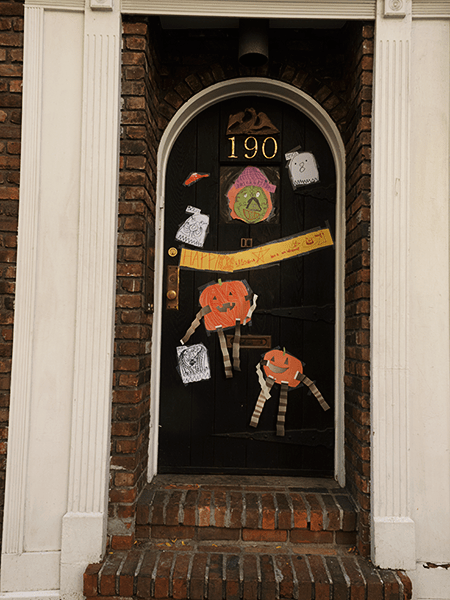 fall and halloween decorations on a door