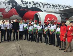 The Caterham pit crew arriving in Thailand with Air Asia crew.