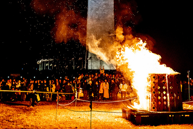 A fire spinner is seen just prior to the vigil burn at Catharsis on the Mall