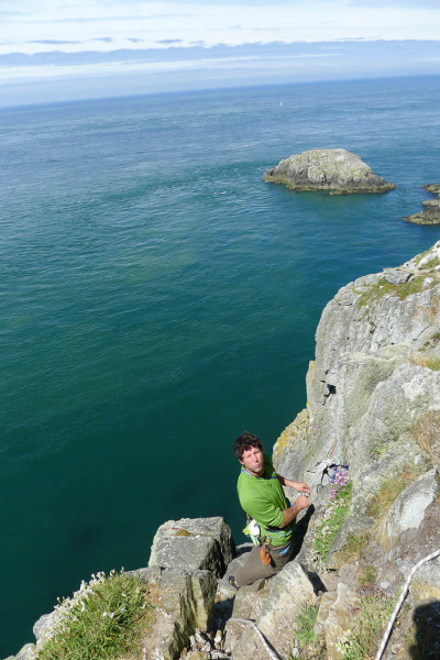 Geeking out whiile figuring out how to get down there! Wen Zawn, Gogarth. Anne Skidmore photo.