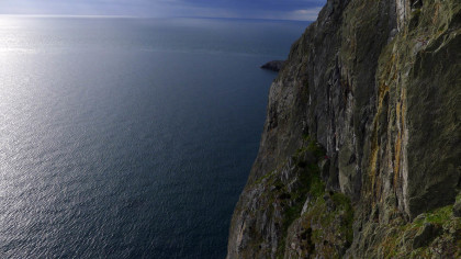 Gogarth's Uper Tier and Main Cliff. Climbers on Energy Crisis. I wish we had stumbled our way down here earlier in the trip.