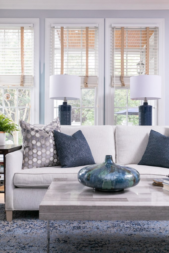 Custom pillows and navy decor accents in Living Room Design - Cat French Design
