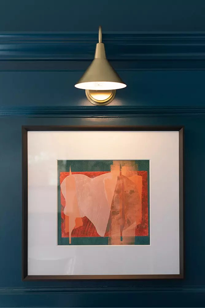 Moody walls, golden sconces and bright artwork - Cat French Interior Design - Chapel Hill
