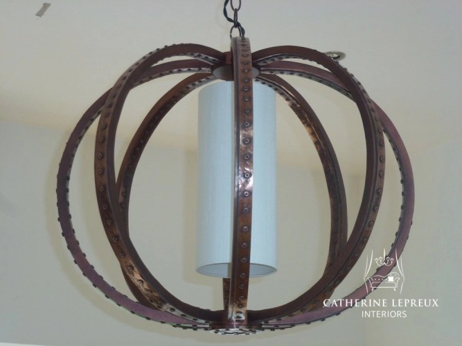 Copper orb pendant light