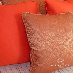 Orange scatter cushions in James Hare silk