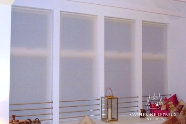 Semi-sheer voile roller blinds in a Perth steading conversion.
