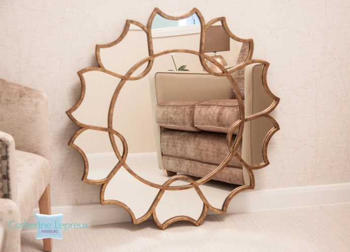 Bronze circular wall mirror. Classic contemporary interior design.