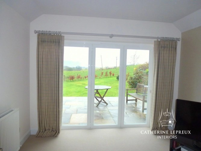 Made to measure interlined curtains in neutral check from Linwood hung from a painted wooden curtain pole