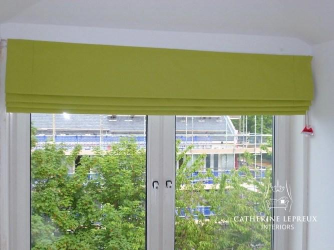 Child safe blackout lined roman blind in an Edinburgh dormer window