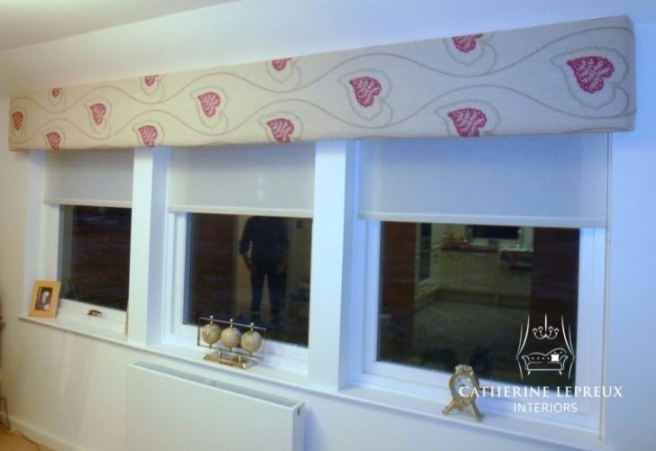 Upholstered pelmet with semi sheer roller blinds in a Perth steading conversion. Fabric is Villa Nova embroidered linen