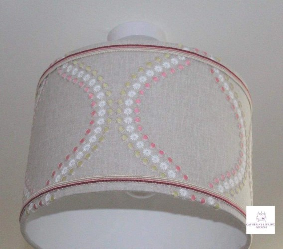 Handmade drum lampshade with pink braid trim in a Fife girl