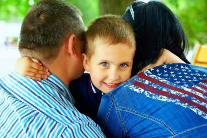 Smiling kid with parents