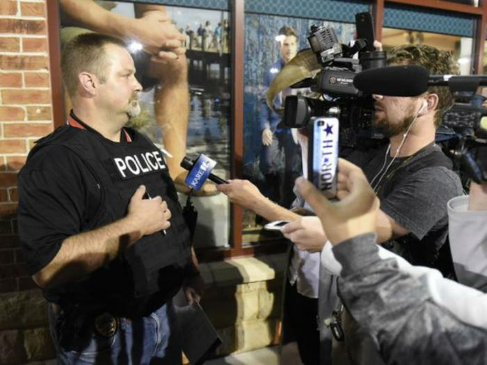 Sgt. Jason Burke of the St. Cloud Police Department answered questions Saturday evening