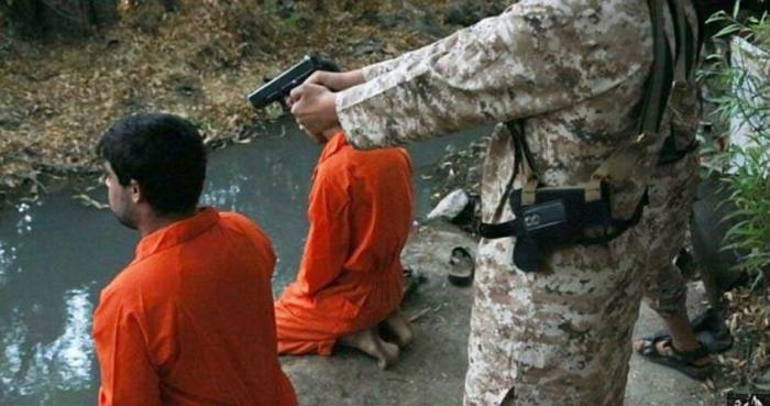 The alleged spies were forced to kneel so the young boys could shoot them.