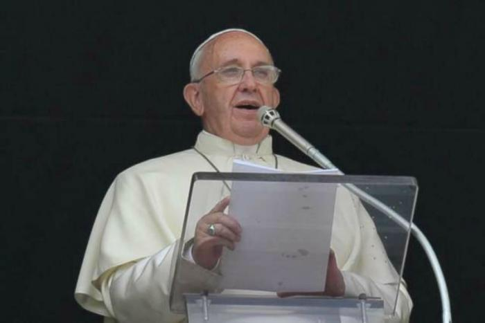 Pope Francis delivers the Angelus address .