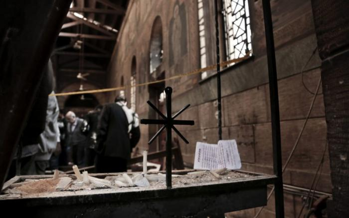Security forces examine the scene within the damaged cathedral.