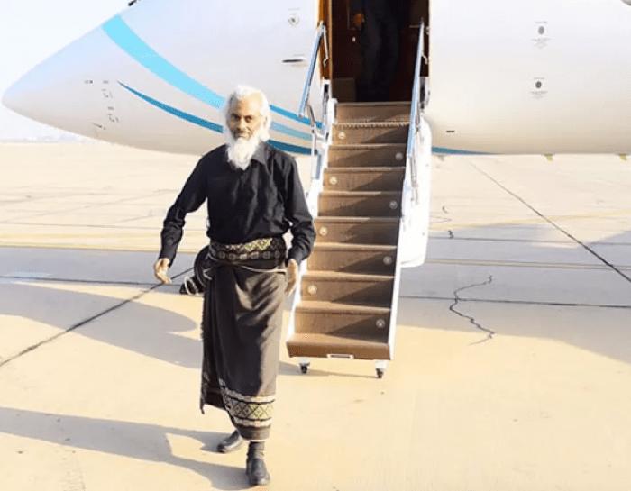Fr Tom walking off a plane