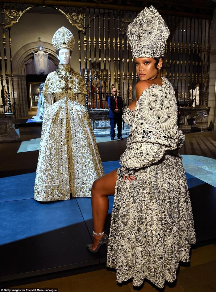 Rihanna dressed as a bejeweled pope.