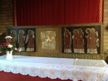 The reredos shows angels in liturgical procession