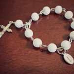 Traveling white rosary for car