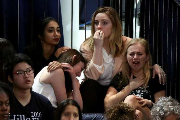 NEW YORK, NY - NOVEMBER 08: A group of women react as voting results come in at Democratic presidential nominee former Secretary of State Hillary Clinton's election night event at the Jacob K. Javits Convention Center November 8, 2016 in New York City. Clinton is running against Republican nominee, Donald J. Trump to be the 45th President of the United States. (Photo by Drew Angerer/Getty Images)