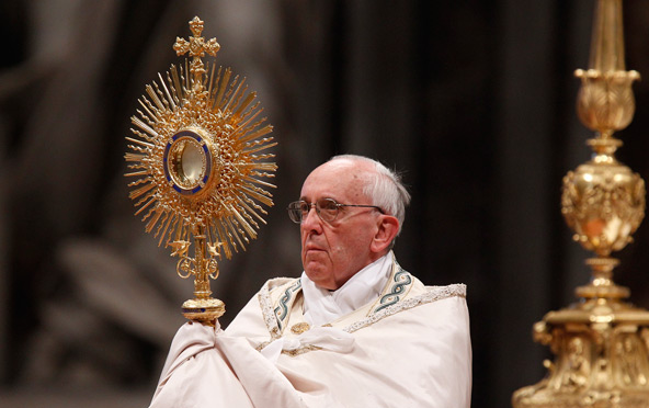 Pope Francis holding a Monstrance at Eucharistic Adoration
