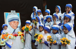 Girls dressed up as Blessed Mother Teresa during an Aug. 26 event to commemorate her 104th birth anniversary in a school in Bhopal, India. Mother Teresa was born Agnes Gonxha Bojaxhiu Aug. 26, 1910, to Albanian parents in Skopje, in present-day Macedonia. She died in 1997 and was beatified by Pope John Paul II in 2003. (CNS photo/Sanjeev Gupta, EPA)
