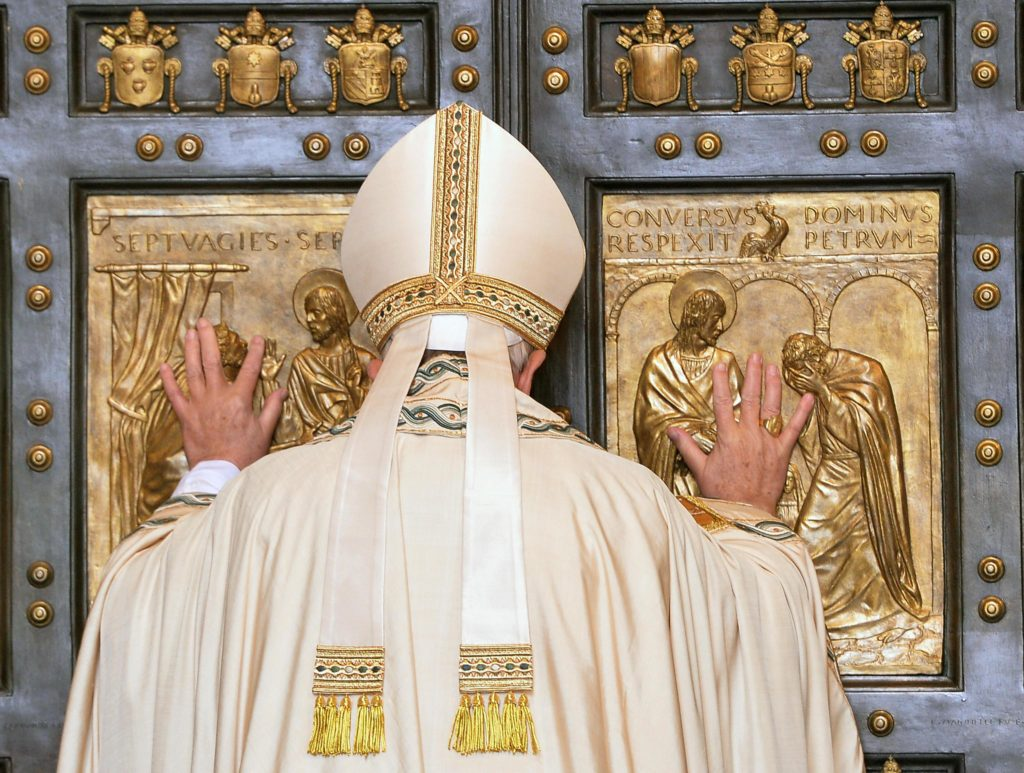 Pope Francis opens the Holy Door of St. Peter's Basilica to inaugurate the Jubilee Year of Mercy at the Vatican Dec. 8. (CNS photo/Maurizio Brambatti, EPA)