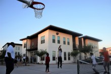 Children play basketball on the court at the Rosewood Court affordable housing complex during the complex's grand opening Oct. 25. (Jeff Grant/CATHOLIC SUN)