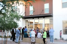 A reception takes place outside the community room at the Rosewood Court Apartments during the complex's grand opening Oct. 25. (Jeff Grant/CATHOLIC SUN)