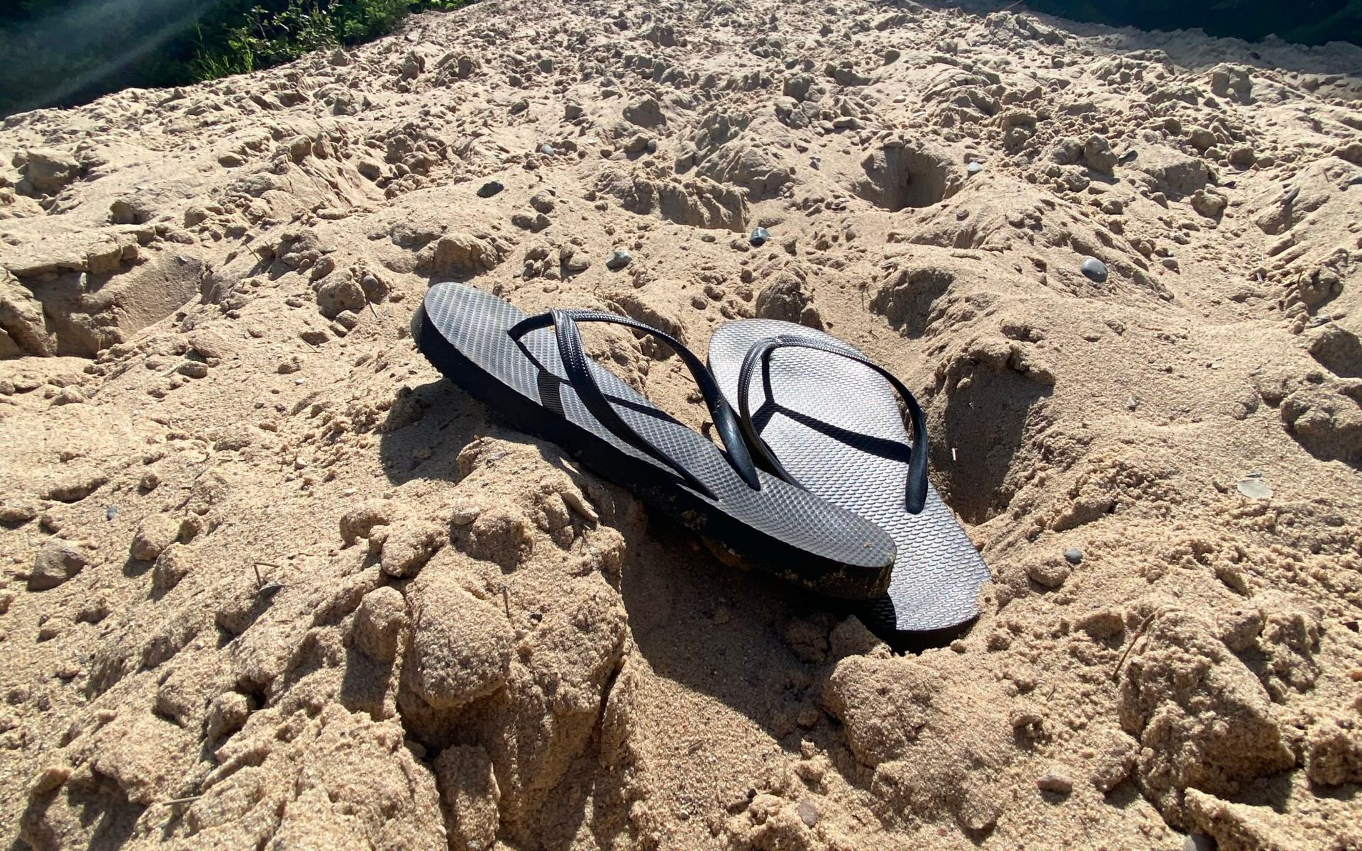Flip Flops at Bottom of Sand Dune