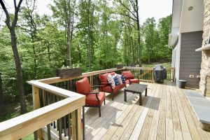 outdoor wooden deck with outdoor fireplace maryland