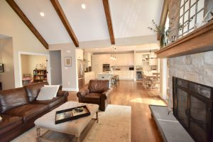 open concept new home wooden beams