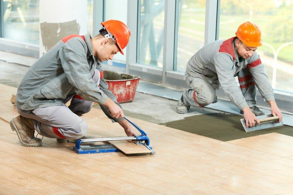 installing floor tiles