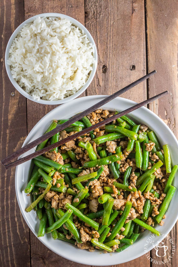 Szechuan Green Beans & Pork is an approachable, easy recipe that is incredibly tasty and feeds a family in about 15 minutes!