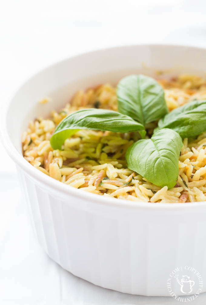 This recipe for Creamy Parmesan Orzo with basil is a tasty, easy side dish that goes with a wide variety of main dishes and is ready in 30 minutes!