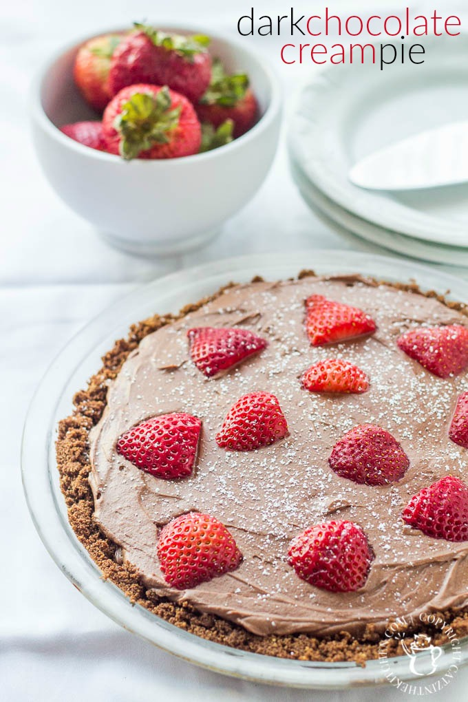 Dark Chocolate Cream Pie with fresh strawberries! This pie recipe is sweet but not too sweet, with deep cocoa flavor - definitely for the true chocolate lover!