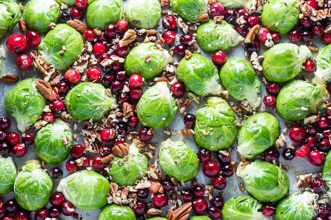 Maple Roasted Brussels Sprouts with Cranberries is a side dish recipe that is easy to make, incredibly flavorful, and just looks like Christmas!