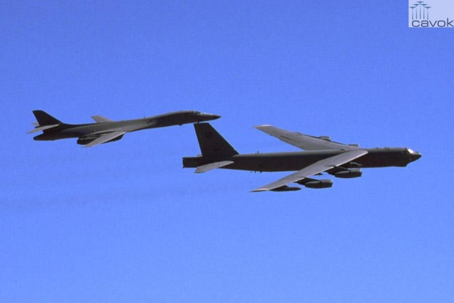 Boeing B-52H Stratofortress  flying in formation with a Rockwell B-1B bomber, by AirNikon