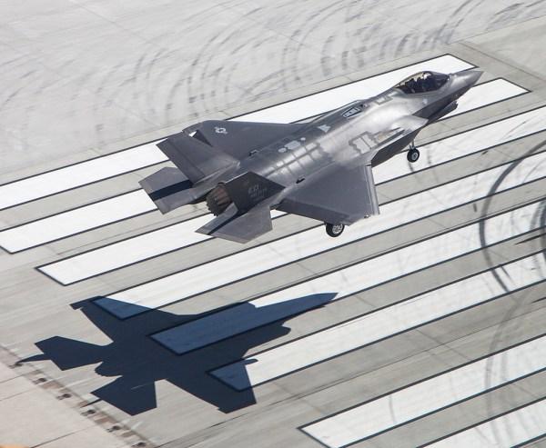 air_f-35a_landing_tom_reynolds_2013_lmco_lg