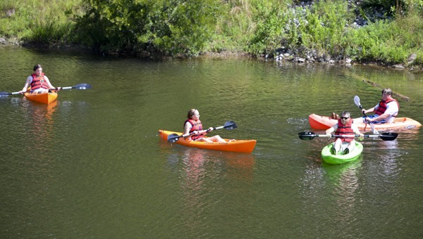 Children participate in outdoor nature camp using Cawaco kayaks.
