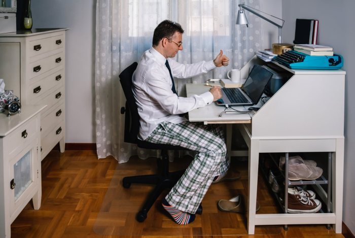 While working from home, it's important to dress as if you were going to the office. Don't stay in your pajamas, like this guy.
