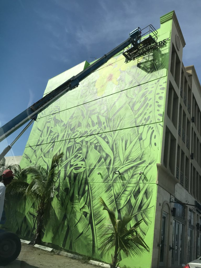 Mural in progress on Harbour Drive in George Town