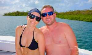 couple on a private boat outr of Grand Cayman's mangroves