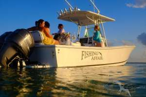 ladies relaxing on our regulator 26fs charter boat in grand cayman