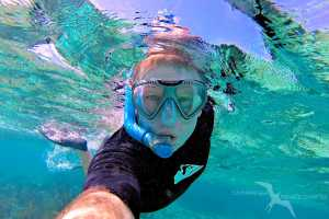 the owner of cayman sea private charter snorkeling the reef
