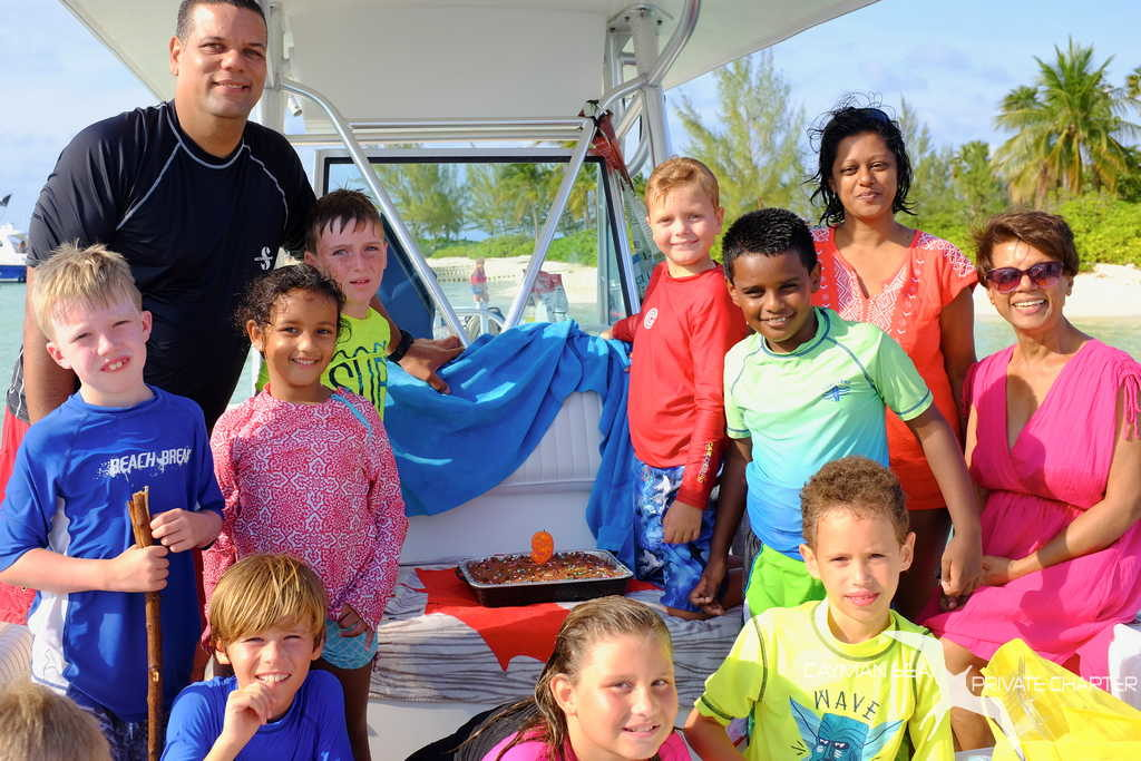 private boat charter to starfish point grand cayman for kids birthday party