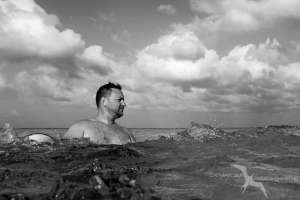 man in the waves at stingray city grand cayman