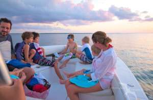 family on our charter boat during a sunset cruise in grand cayman